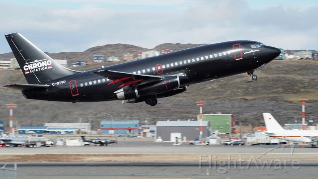 """Boeing 737-200 (C-GTVO) - """"MatBlack"""", which is matte black. Chrono Aviation C-GTVO a Boeing 737-200. leaving Iqaluit on August 15, 2019  It appears to have a skid plate on its front wheels, for landing at Mary River, Nunavut"""
