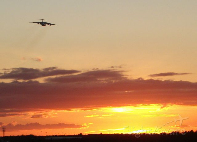 — — - IL-76 taking off into the sunset