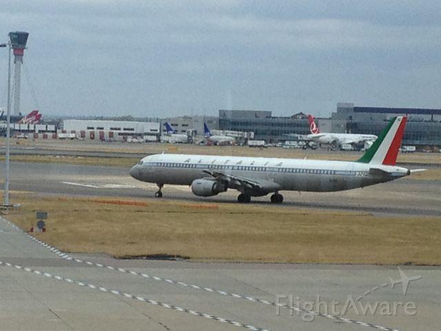Airbus A321 (EI-IXI) - Alitalia A321 in retro livery.  Saw it from Terminal 4 at Heathrow