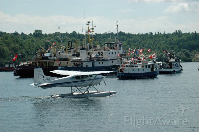 Cessna Commuter (C-GYLN) - 1977 Cessna 180K Skywagon (180-52794) departing from Parry Sound Harbour Water Aerodrome (CPS1) during Tugfest on August 27, 2011
