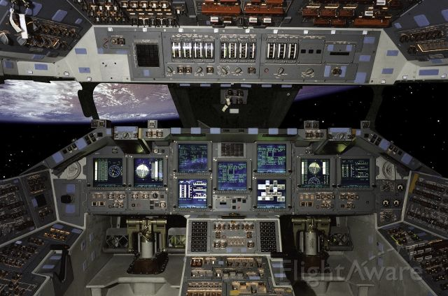 """STS101 — - The """"glass cockpit"""" installed on the Space Shuttle: JSC2000-E-10522 (March 2000) -- Eleven new full-color, flat-panel display screens in the Shuttle cockpit replace 32 gauges and electromechanical displays and four cathode-ray tube displays. The new """"glass cockpit"""" is 75 pounds (34 kg) lighter and uses less power than before, and its color displays provide easier pilot recognition of key functions. The new cockpit is expected to be installed on all shuttles in the NASA fleet by 2002, and it sets the stage for the next cockpit improvement planned to fly by 2005: a """"smart cockpit"""" that reduces the pilots workload during critical periods. During STS-101 Atlantis will fly as the most updated shuttle ever, with more than 100 new modifications incorporated during a ten-month period in 1998 at Boeings Palmdale, Ca., Shuttle factory."""