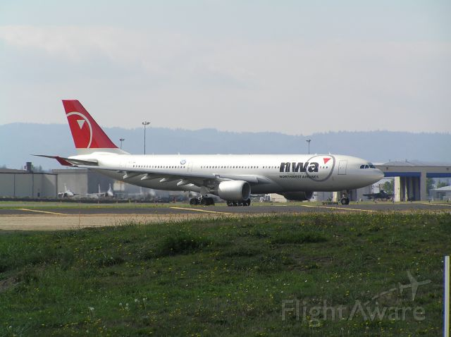 Airbus A330-200 (N854NW) - Shot from Cell-Phone Waiting Area, approach end of 28L; date: Sep 26 2004