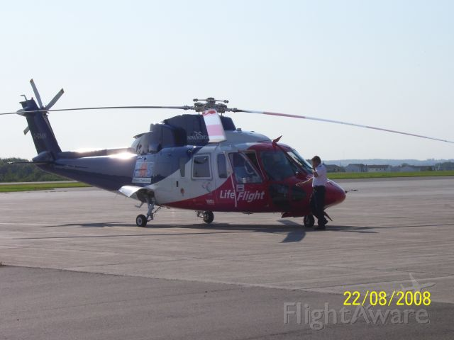 Sikorsky S-76 (C-GIMN) - On the apron at CYYG for a fuel stop.