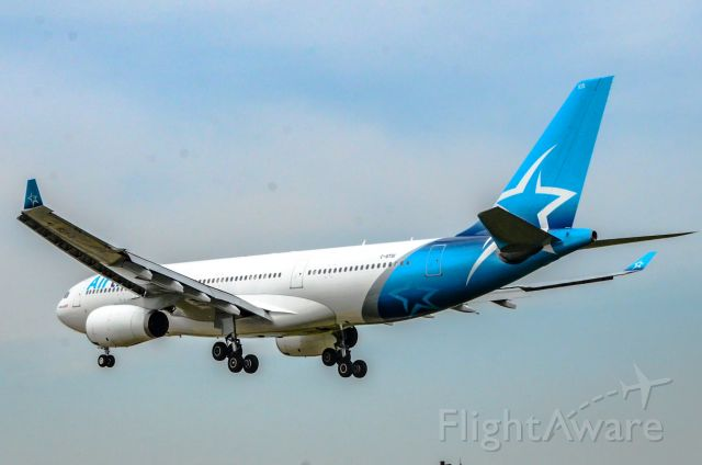 Airbus A330-200 (C-GTSI) - Here is a Air Transat new livery soaring over airport road at CYYZ