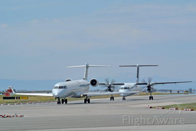 Canadair Regional Jet CRJ-900 (C-FCJZ) - Bombardier regionals taxiing out to Rwy 26L AC8114, 8572
