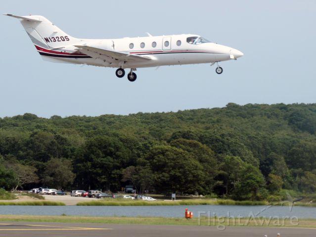 Beechcraft Beechjet (N132QS) - Netjets. Final approach.