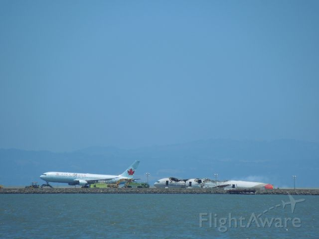 Boeing 777 (HL7742) - Air Canada 767 was the first landing on 28R in over 24 hours after the crash of Asiana 214.