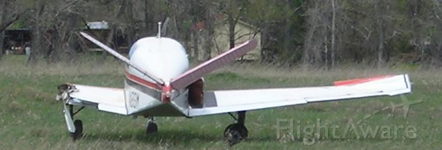 Beechcraft 35 Bonanza (N8SM) - Aircraft in the field the day following the accident.