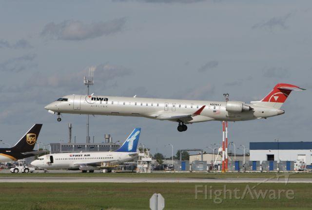 Canadair Regional Jet CRJ-900 (N928XJ) - August 18, 2009 - arrived Winnipeg from Minneapolis