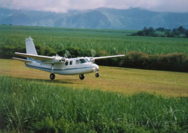 Aero Commander 500 (CHQ48) - Landing at Nasuli in the southern Philippines