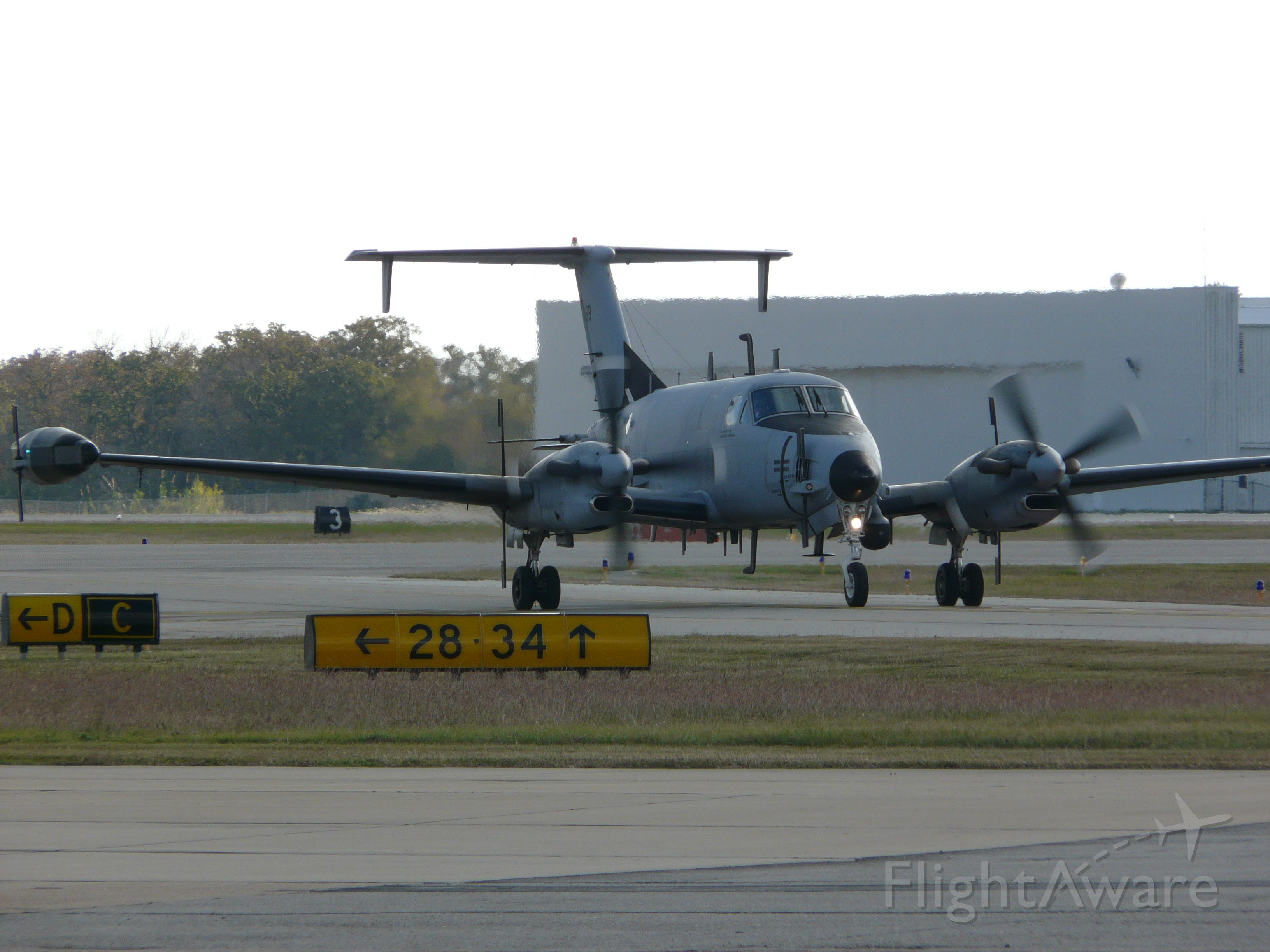 """— — - This RC-12 SIGNET aircraft was spotted at College Station, TX. Sorry for the poor shot but here's the link to the info: <a rel=""""nofollow"""" href=""""http://defensetech.org/2011/02/08/first-rc-12x-sigint-spy-planes-making-their-way-downrange/"""">http://defensetech.org/2011/02/08/first-rc-12x-sigint-spy-planes-making-their-way-downrange/</a>"""