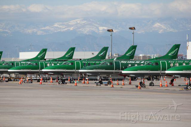 Fairchild Dornier SA-227DC Metro (N787KL) - 15 Metroliners lined up at DIA cargo on Thanksgiving day 2012.