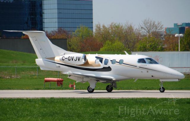 Embraer Phenom 100 (C-GVJV) - JV's Phenom 100 C-GVJV arriving @ Toronto's Buttonville - just arrived from Washington Dulles - and heading home to Lake Simcoe Regional Airport - May 19 2014