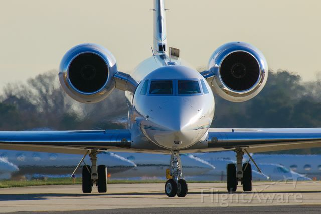 Gulfstream Aerospace Gulfstream V (N728AG) - GV taxiing at PDK airport in Atlanta during Super Bowl week 2019. Notice billionaire's row of jets in the background.