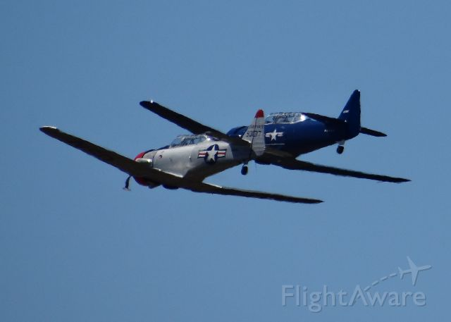 North American T-6 Texan (N93137) - Interesting optical illusion on these two texans.