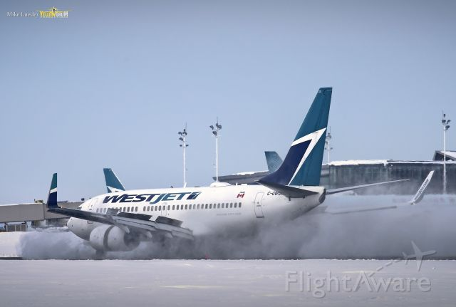 Boeing 737-700 (C-GWCN) - The day after 51cm of snow fell on Ottawa it was business as usual at CYOW.