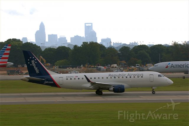 N402YX — - 402YX taking off at CLT with the city in the background