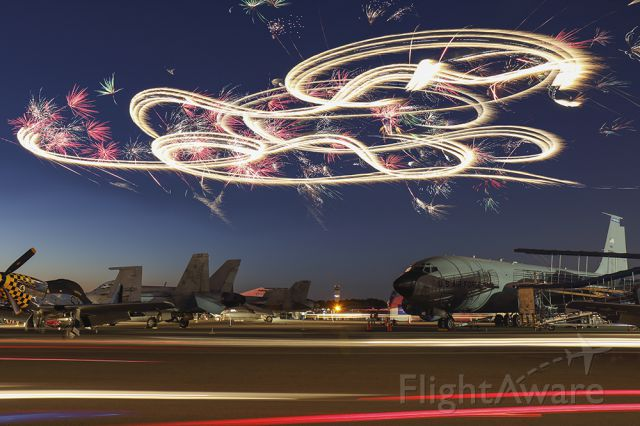 — — - Aerial fireworks display where the fireworks are attached to an aircraft. Really cool long exposure photo from Sun N Fun in Lakeland Florida.