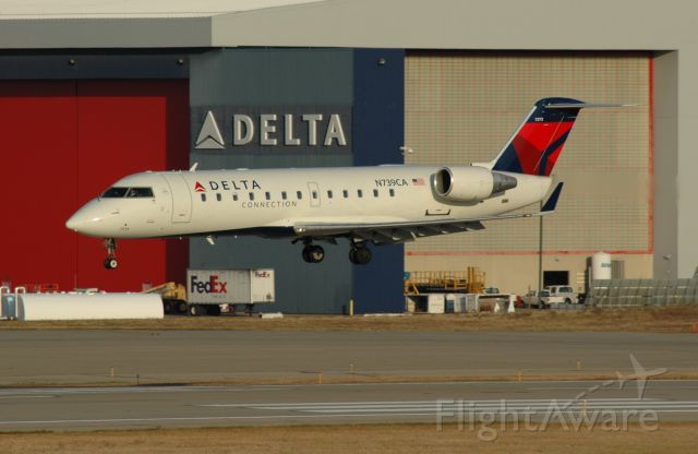 Canadair Regional Jet CRJ-100 (COM9451) - early morning landing on 18 left.
