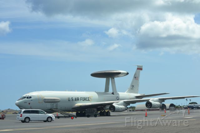 — — - An AWACS airplane on the ground at Hickam field on Oahu in Hawaii.