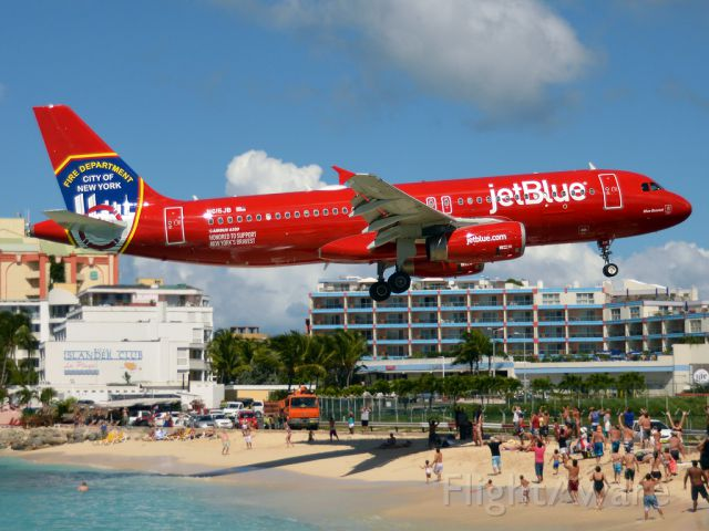 Airbus A320 (N615JB) - JetRed  bka as Blue Bravest. Seen here over Maho just about to touch down from Boston.