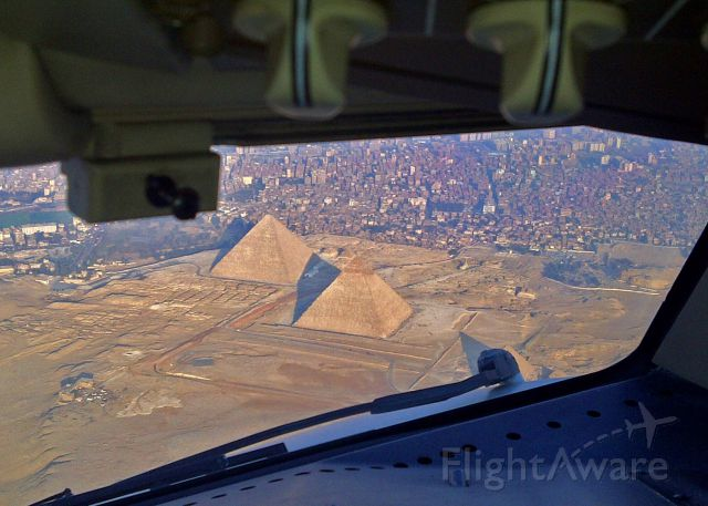 — — - Giza pyramids while on final approach to Cairo on 1/24/2011.  The riots started the next day as we watched from our hotel balcony overlooking Tahir Square.