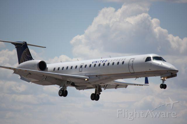 Embraer EMB-145XR (N24103) - Landing on 35L.