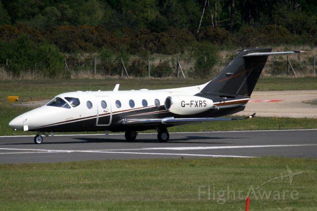 Beechcraft Beechjet (G-FXRS) - FlairJet Beechjet 400XT backtracking to depart rwy 06 on 15-May-19 heading for LSGG as FLJ54.