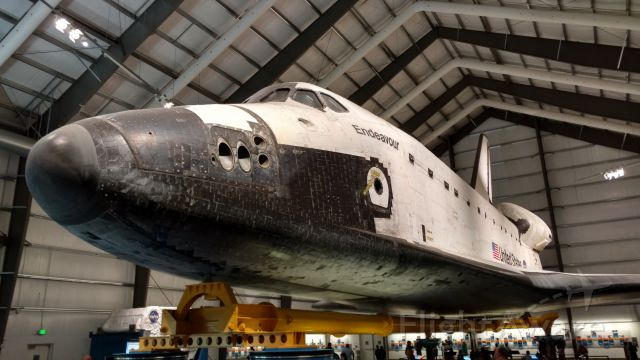 — — - Visit to Cal Science Center last week to see Endeavor.  Plans are afoot in the next few years to get an orange fuel tank from Louisiana and two white boosters from Utah, mount them and stand the whole thing upright with a completely new vertical enclosure.