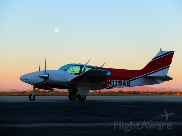 Beechcraft 55 Baron (N119AB) - Sunrise MoonSet over Air-Attack Baron.