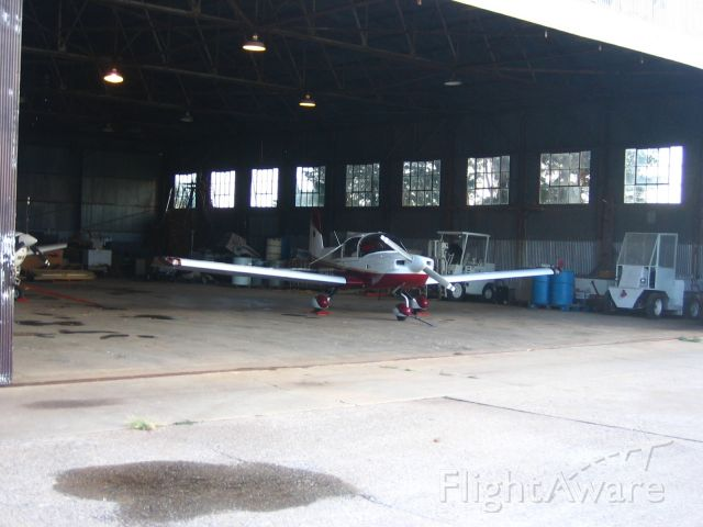 Grumman AA-5 Tiger (N929TE) - Old United States Army Air Forces (USAAF) hanger in Enid, OK