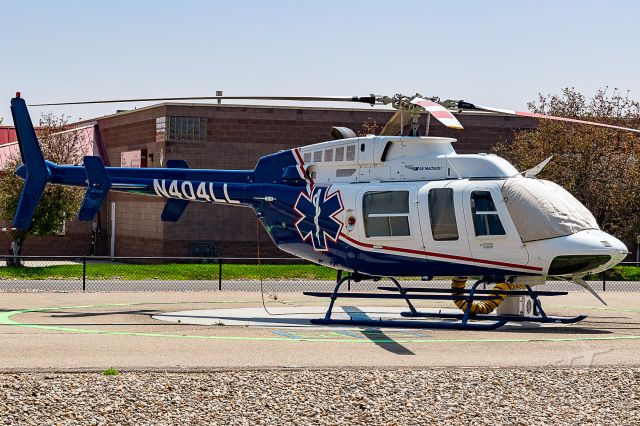 Bell 407 (N404LL) - On the pad at Frederick-Firestone Fire Protection District (CO) station #2. 17 July, 2018