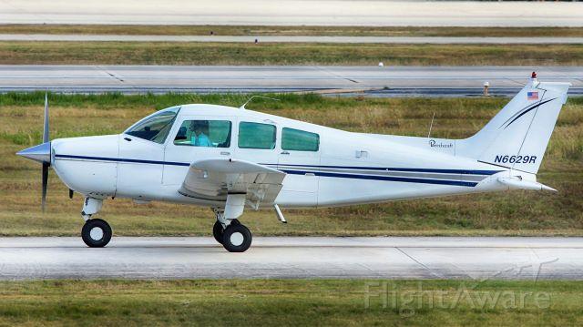 Beechcraft Sundowner (N6629R) - Taxiing to 22 for departure.