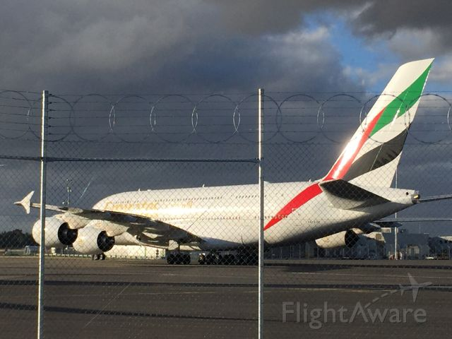 Airbus A380-800 (AE-EUM) - Emirates A380 backed up for departure from Christchurch under barbed wire.