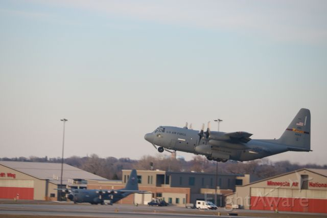 Lockheed C-130 Hercules (61003) - First of two C130's taking off just a few minutes before sunset