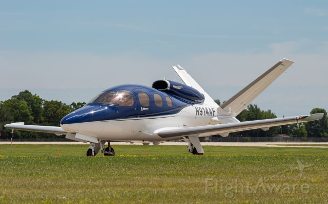 Cirrus Vision SF50 (N914AF) - A Cirrus SF-50 Vision Jet vacating the runway at Oshkosh after a 2 hour flight from Nashville.
