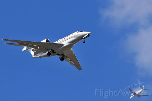 Cessna Citation X (N769XJ) - N769XJ on short final to runway 9L at OPF as WestJet B737-7CT C-FWSI is on downwind for runway 12 at MIA