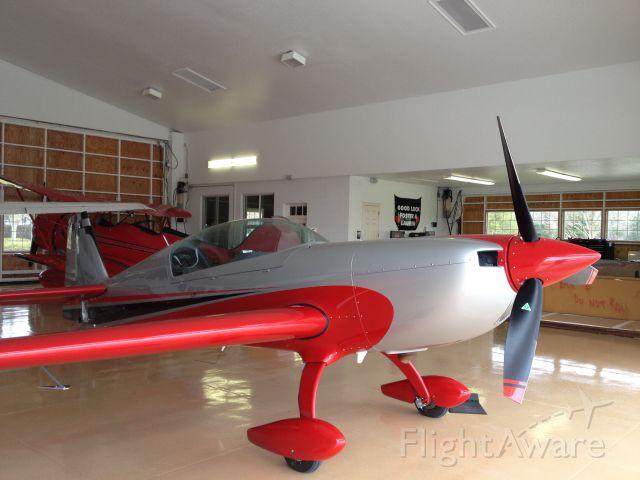 Piper Cherokee (N330FB) - Sittin' pretty in the hangar at Leeward