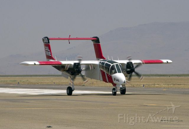 N421DF — - In for fuel while serving as lead plane for retardant aircraft, Cal Fire OV-10 taxis to the fueling station at Siskiyou County Airport.