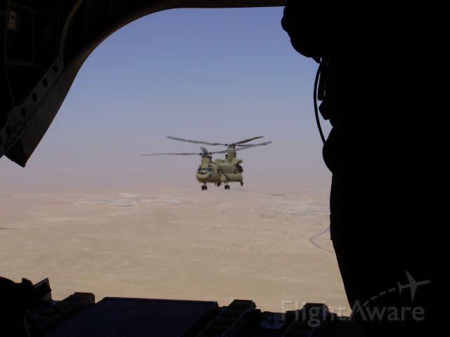 — — - CH-47 Chinook, as seen through the open ramp of another CH-47