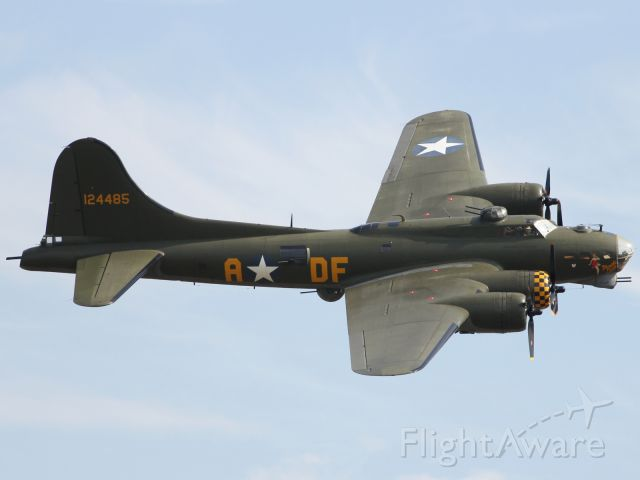 — — - The mighty Memphis Belle, B-17 Flying Fortress, performs a flypast at Duxford Air Museum.