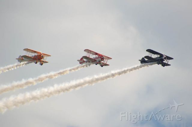 "N806R8 — - Three Boeing Stearman are in formation during their performance at the Fly Iowa Airshow 2019. In the lead is a black and white Stearman registered as N5556R, followed by a Stearman in ""Red Baron"" colorers registered as N806R8, and finally N69249 named 'Dreamsicle',an orange and white Stearman. Photo taken August 2, 2019 with Nikon D3200 at 400mm.n"