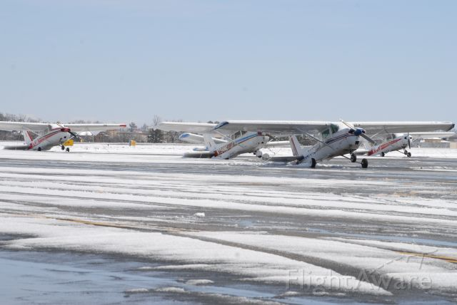 Cessna Skyhawk — - Thank god my plane is in a hangar!  This is a photo of a few Cessnas the morning after the Greenville, SC snowstorm.  Who knew a Cessna could transform itself into a taildragger!
