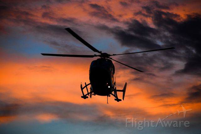 NUSANTARA NBK-117 (C-GCPH) - At a scene call in the County of Grande Prairire, AB - Departing with Patient into the Sunset
