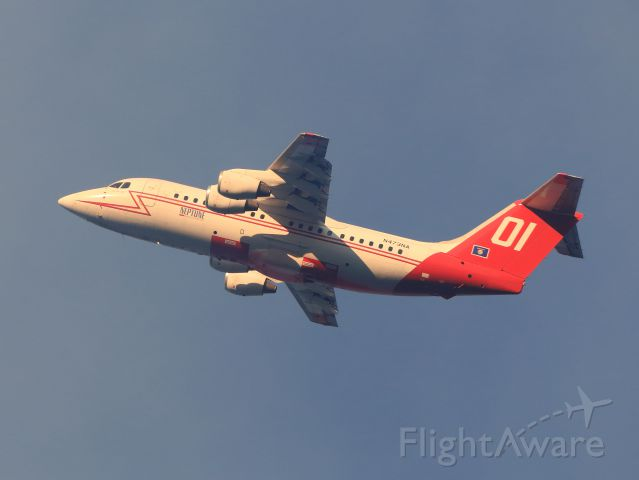 British Aerospace BAe-146-200 (N473NA) - Neptune Aviation Services BAe 146-200 Tanker 01 over the June Fire, June Lake CA., late afternoon 9-16-14.