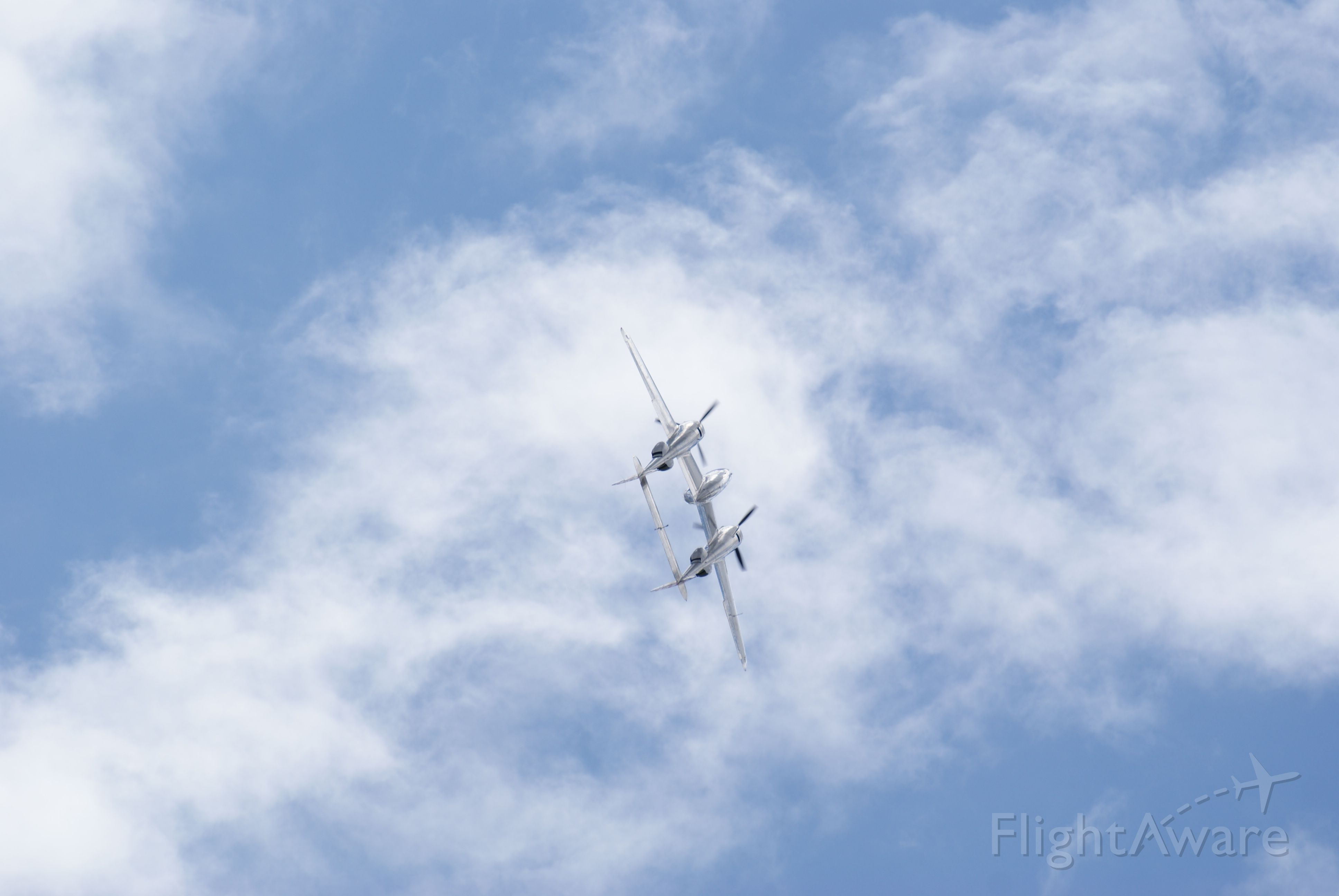 Lockheed P-38 Lightning (N25Y) - The Red Bull Lightning part way thru the barrel roll at Duxford Flying Legends airshow July 12