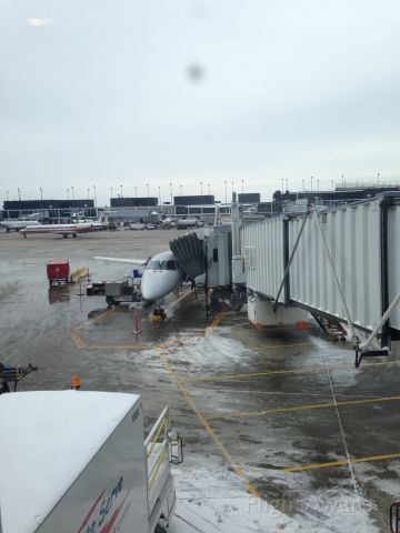 Embraer ERJ-145 — - Waiting at the gate at KORD, destination is KTYS