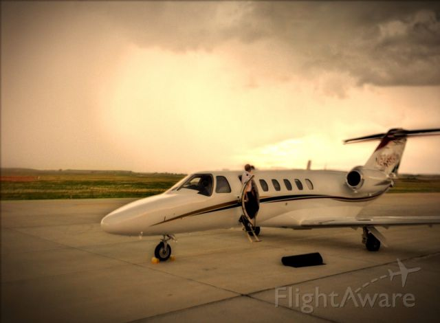 Cessna Citation CJ1 (N245SP) - Just beat the evening t-storms into Sheridan Wyoming. It was a beautiful background.