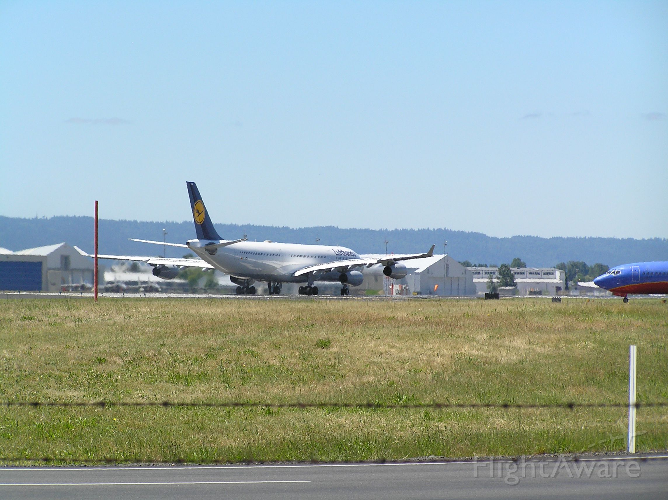 Airbus A340-300 (D-AJGJ) - rolling... enroute KPDX-EDDF, 2008-06-14; PDX revenue could not sustain this flight