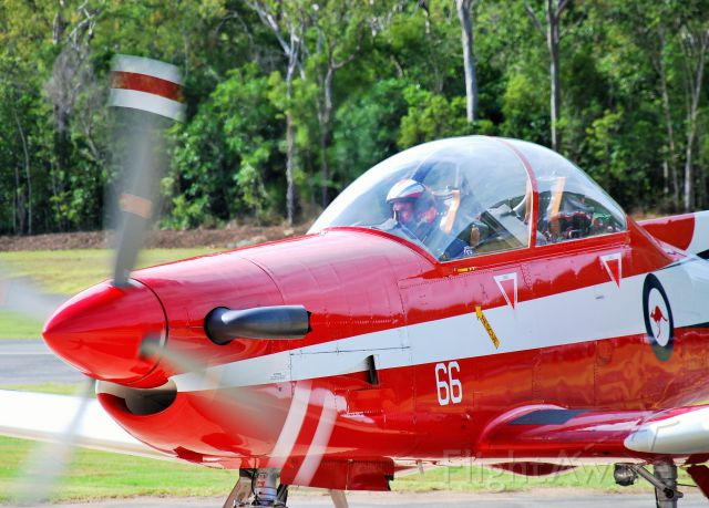 HAWKER DE HAVILLAND PC-9 — - RAAF Roulettes PC-9 finishes an aerobatic display at Airlie beach, Qld.